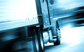 10645091 - semi truck in motion. semi track speeding on the american highway. motion blurred. blue tones. transportation and spedition photo collection.